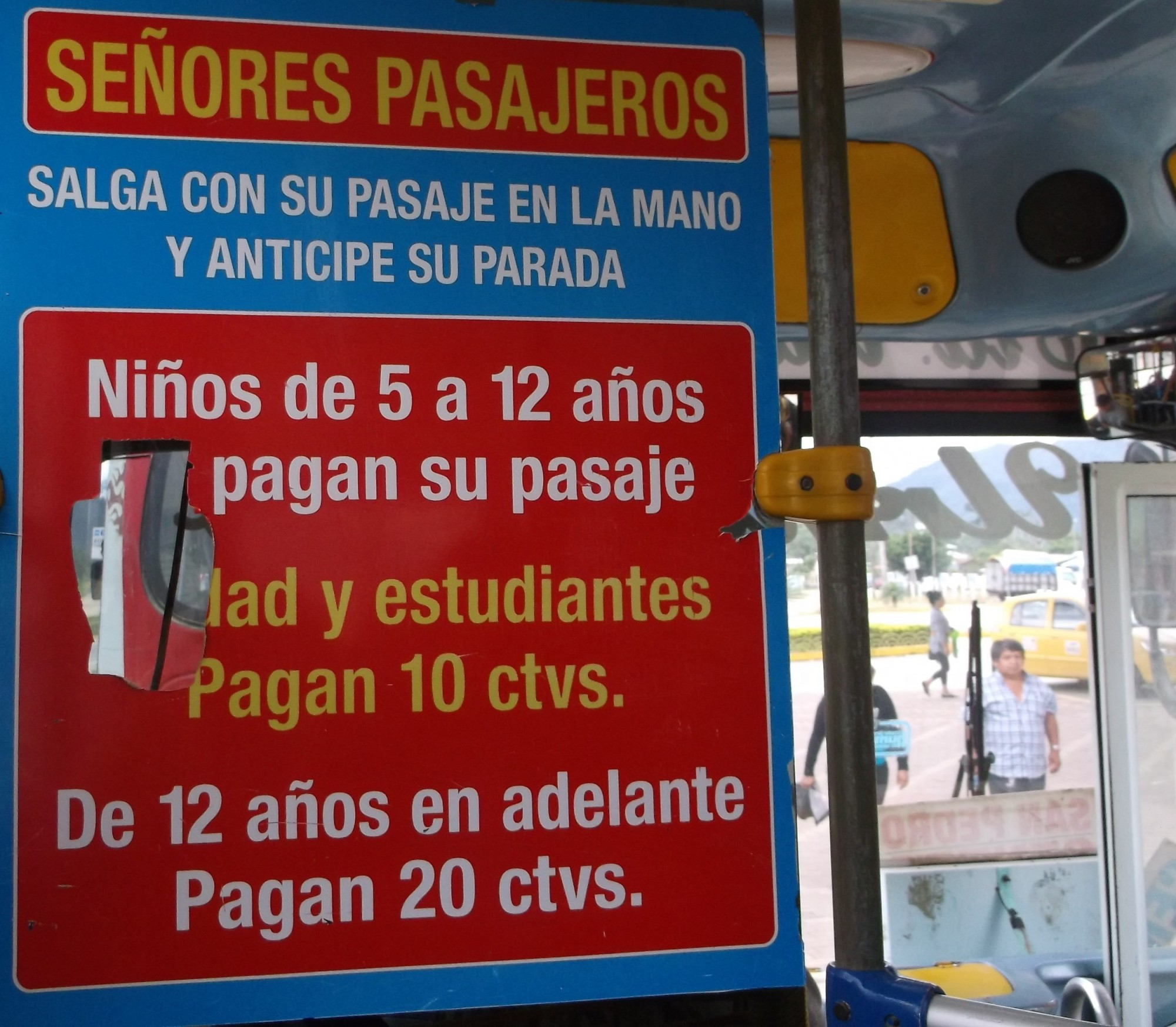 "This is a sign on one of the buses we rode while in Ecuador. The word ""Pagans"" on the sign caught our attention! Language diversity!"